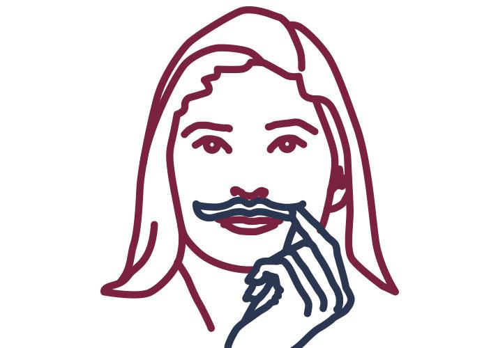 Frau hält sich Schnurrbart vors Gesicht